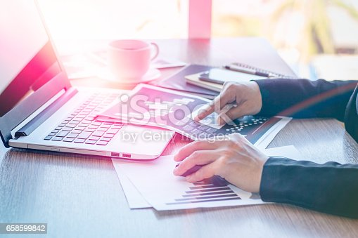 658588384istockphoto Close Up businessmen working at a coffee shop 658599842