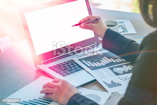 658588384istockphoto Close Up businessmen working at a coffee shop 658600034