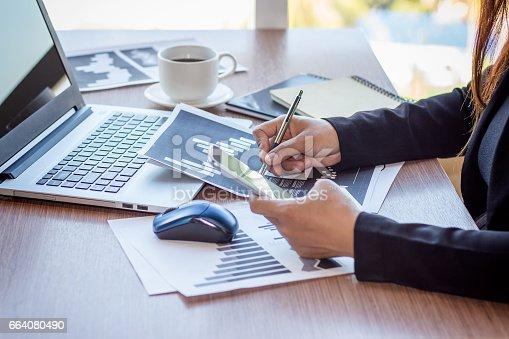 658588384istockphoto Close Up businessmen working at a coffee shop 664080490