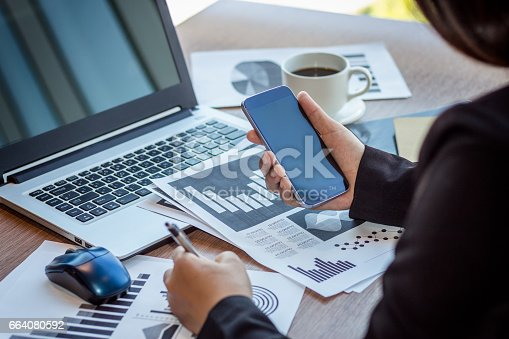 658588384istockphoto Close Up businessmen working at a coffee shop 664080592