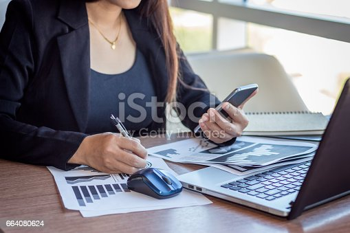 658588384istockphoto Close Up businessmen working at a coffee shop 664080624