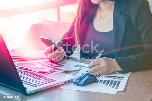 658588384istockphoto Close Up businessmen working at a coffee shop 664081098
