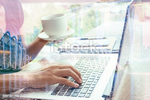 658588384istockphoto Close Up businessmen working at a coffee shop 696182286