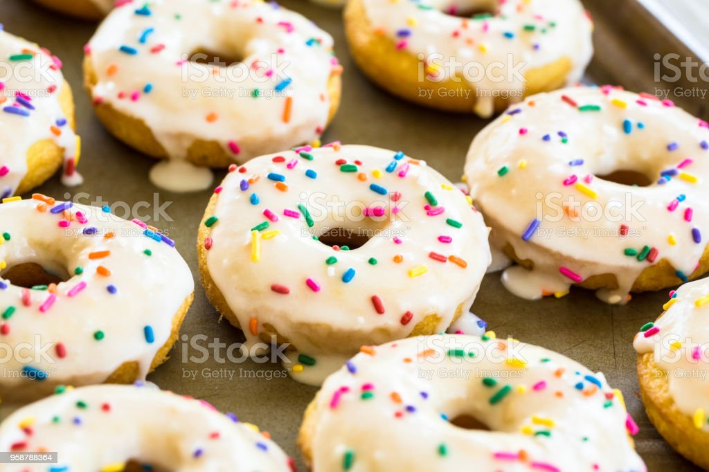 Close Up Cake Donuts With Icing and Sprinkles stock photo