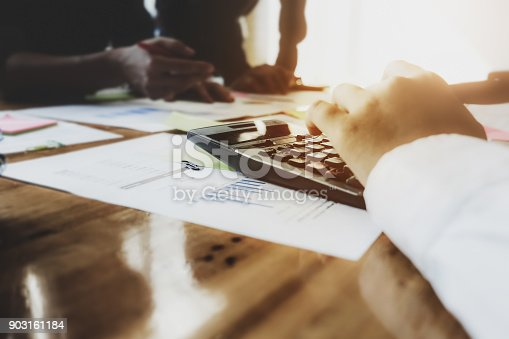 881542122istockphoto Close up calculator, Business People Meeting Corporate Communication with using pen, notebook and graph chart in at office. Teamwork Concept 903161184
