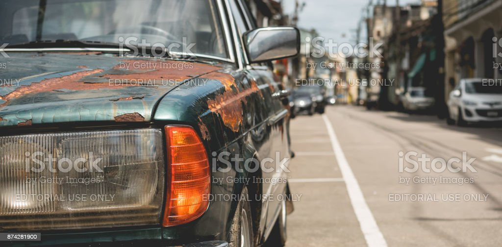 Close - up Car headlights of old car with Rust on the car in transport concept. stock photo