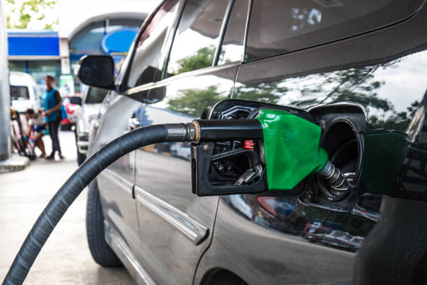 Close up, Car refueling on petrol station. Fuel pump with gasoline. Close up, Car refueling on petrol station. Fuel pump with gasoline biodiesel stock pictures, royalty-free photos & images