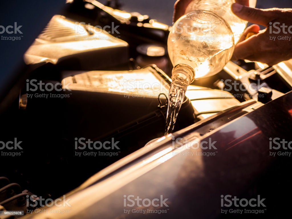 close up car repairing, pouring water in the motor royalty-free stock photo