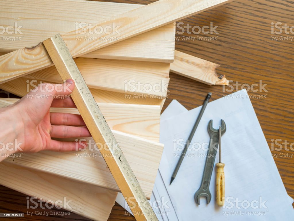 close up carpenter hand creating details with wooden material stock photo
