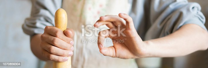 istock close up chef hands holding rolling pin and preparing food f 1070856304
