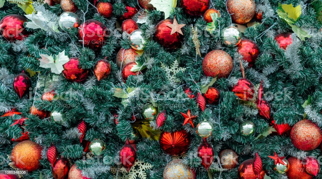 https www istockphoto com photo close up christmas tree decoration with red ball gold ball golden snowflake red star gm1065348306 284881944