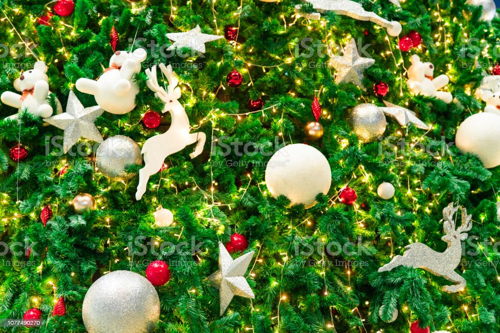 Close Up Christmas Tree Decoration With Red Gold Silver And White Balls Silver Star And White Reindeer Xmas Background Christmas And Happy New Year Background Colorful Ball On Christmas Tree Stock Photo