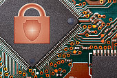 close up circuit digital chip with lock logo. security technologies concept.