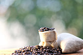 Close up coffee beans on wooden background and space for text