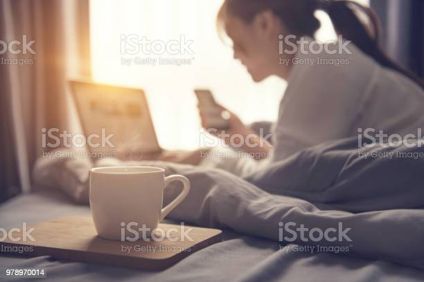 Close up coffee cup and blurred woman wake up and working with laptop picture id978970014?b=1&k=6&m=978970014&s=612x612&h=uxlr33nufkwsnbmqgfm7n lacc7gnrpaubi7hg4pf1e=