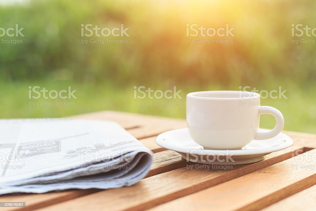 Close up Coffee cup and newspaper on the table stock photo