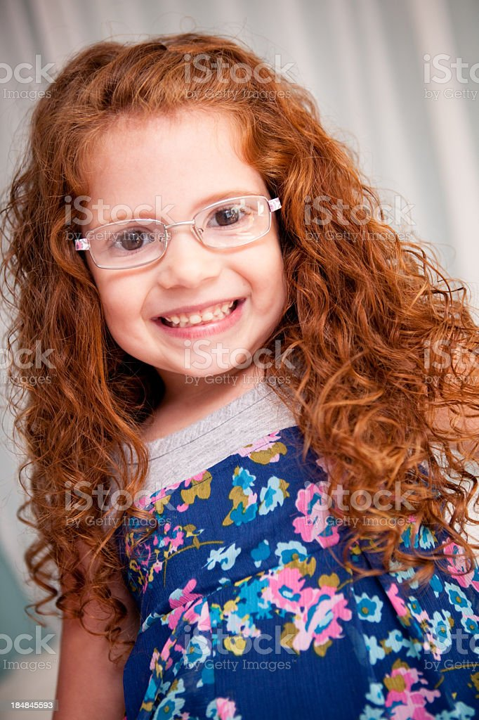 Close Up Color Image of Happy Girl Wearing Glasses royalty-free stock photo