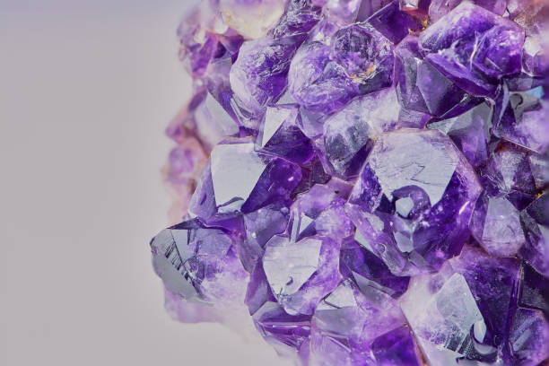 close up color picture of amethyst macro color photo of amethyst with focus stacking against white background geode stock pictures, royalty-free photos & images
