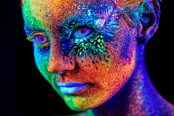 close up color uv portrait - fluoreszierend stock-fotos und bilder