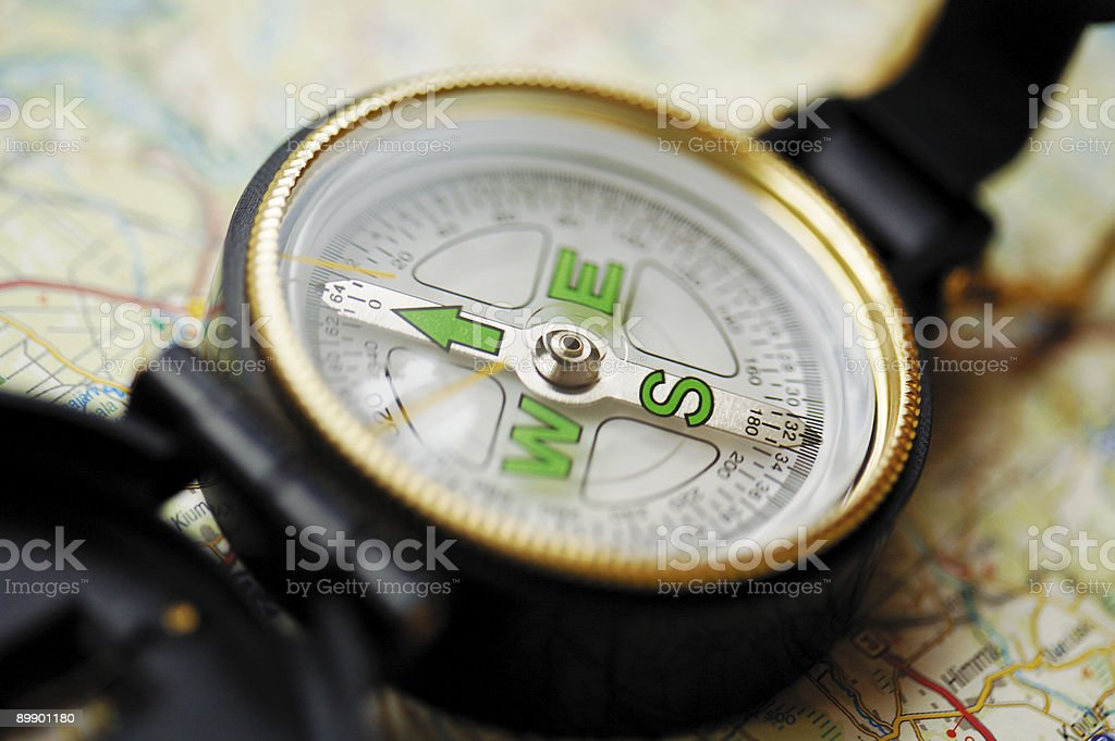 Close up compass on the map stock photo