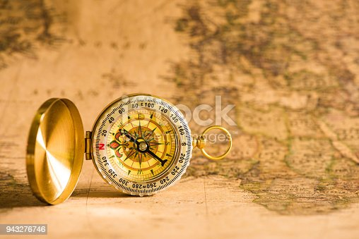 istock Close up Compass on the retro map 943276746