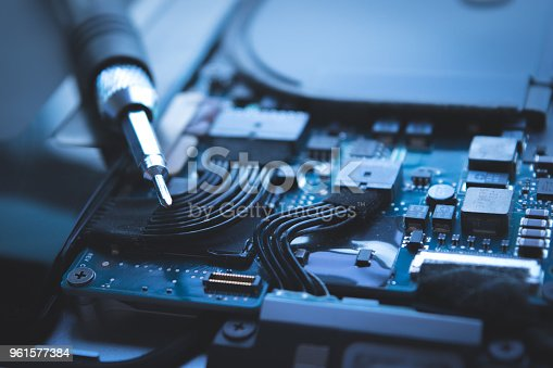 istock close up computer laptop hard disk drive repair blue background 961577384