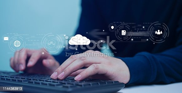 istock close up computer programmer man hand typing on keyboard for transfer or synch data upload and download from cloud computing with virtual interface in operation data center, technology business concept 1144383913