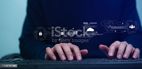 istock close up computer programmer man hand typing on keyboard for transfer or synch data upload and download from cloud computing with virtual interface in operation data center, technology business concept 1145787985