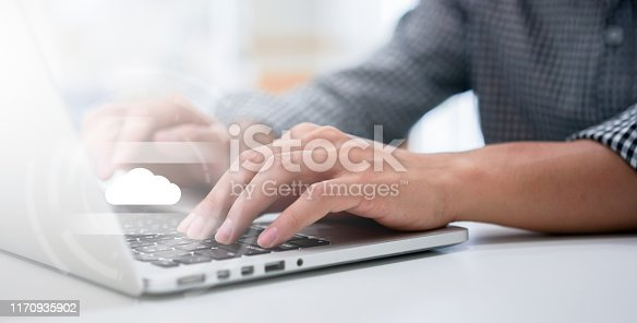 istock close up computer programmer man hand typing on keyboard for transfer or synch data upload and download from cloud computing with virtual interface in operation room, technology business concept 1170935902