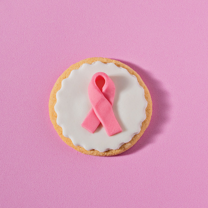 istock Close up cookies with pink ribbon 1084127160