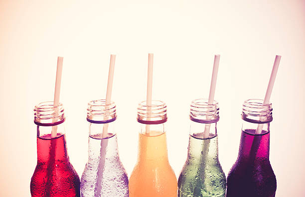 primo piano fresco drink in stile vintage colorato - bottle soft drink foto e immagini stock