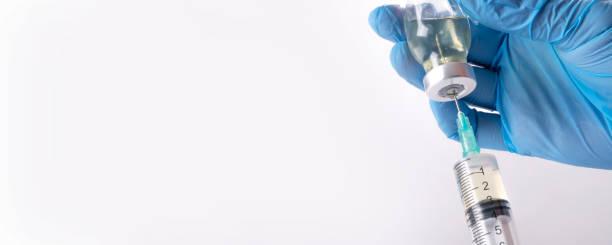 Close up coronavirus vaccine in hand. stock photo