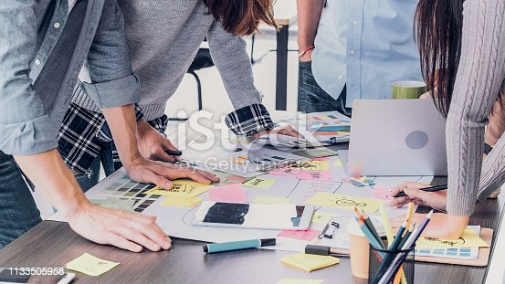 istock Close up creative designer applaud for job success at meeting table at office. 1133505958