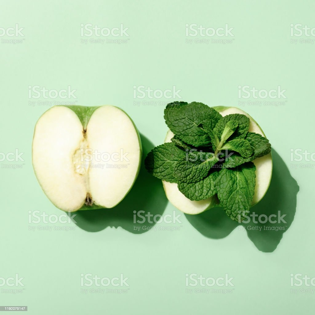 Close up Creative layout made of apple and mint. Flat lay. Food...