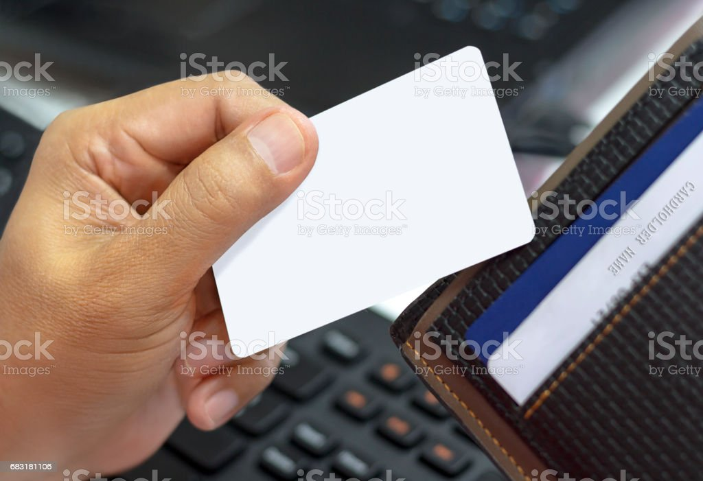 Close up credit card in a male hand and a black wallet, business concept 免版稅 stock photo