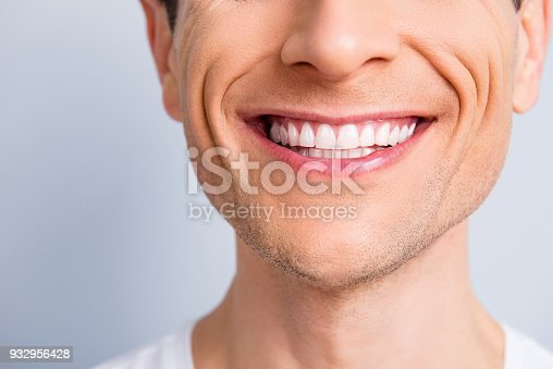 istock Close up cropped half face portrait of attractive, trendy, stylish, experienced, brunet, toothy man with wide beaming smile and healthy teeth, isolated on grey background 932956428