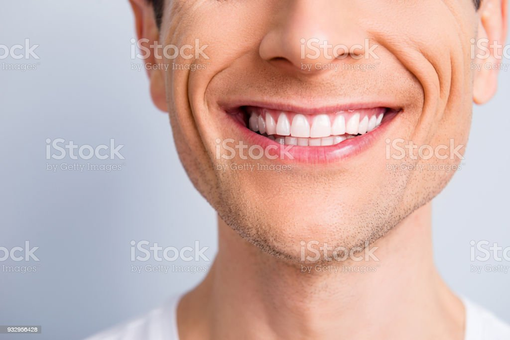 Close up cropped half face portrait of attractive, trendy, stylish, experienced, brunet, toothy man with wide beaming smile and healthy teeth, isolated on grey background stock photo