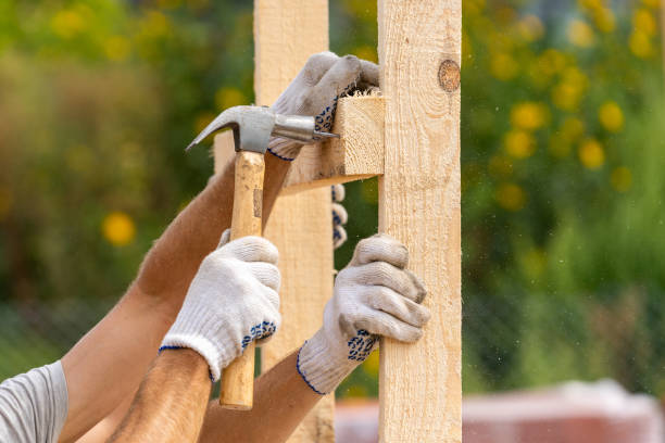Close up cropped photo of two workers in white protective gloves holding plank board installing it on special house hold construction using hammer and nails Close up cropped photo of two workers in white protective gloves holding plank board installing it on special house hold construction using hammer and nails hammer stock pictures, royalty-free photos & images