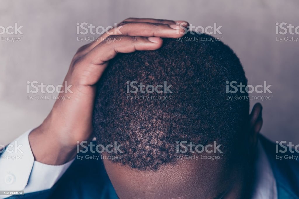 Close up  cropped portrait of successful  handsome afroamerican man in stylish suit touching his hair stock photo