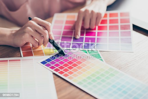 istock Close up cropped portrait of woman's hands holding tablet pen choosing colour from color palettes, sitting at desktop in work station, place 959601294