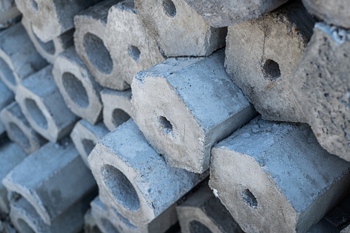 905087856 istock photo Close up cross-sectional area of stacked of concrete pile stake 1272750298
