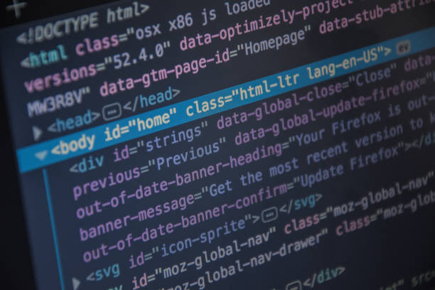 Close up css HTML code on monitor screen with black background stock photo