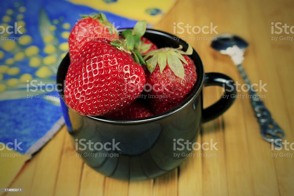 Close up Cup of Strawberries  with Spoon Effect stock photo
