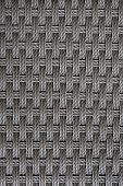 Dark grey rattan weave seamless pattern background.