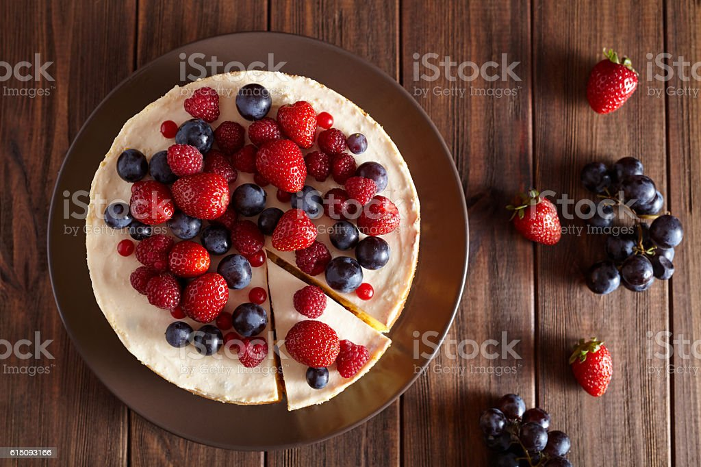 Close up. Delicious Homemade creamy New York Cheesecake with berries stock photo