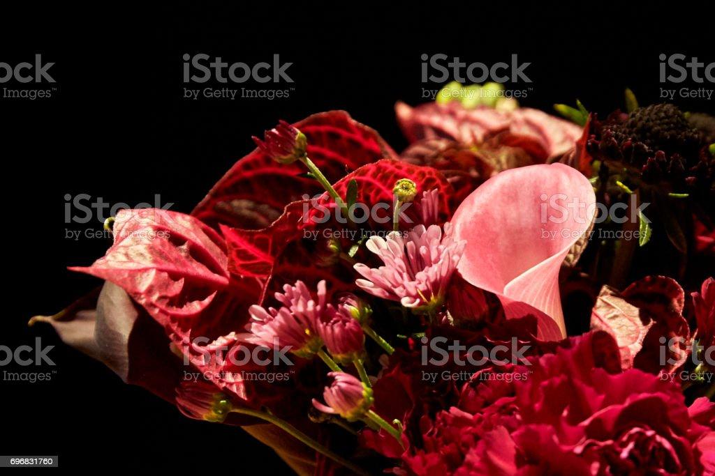 Close Up Detail of a Floral Arrangement on Black Background stock photo
