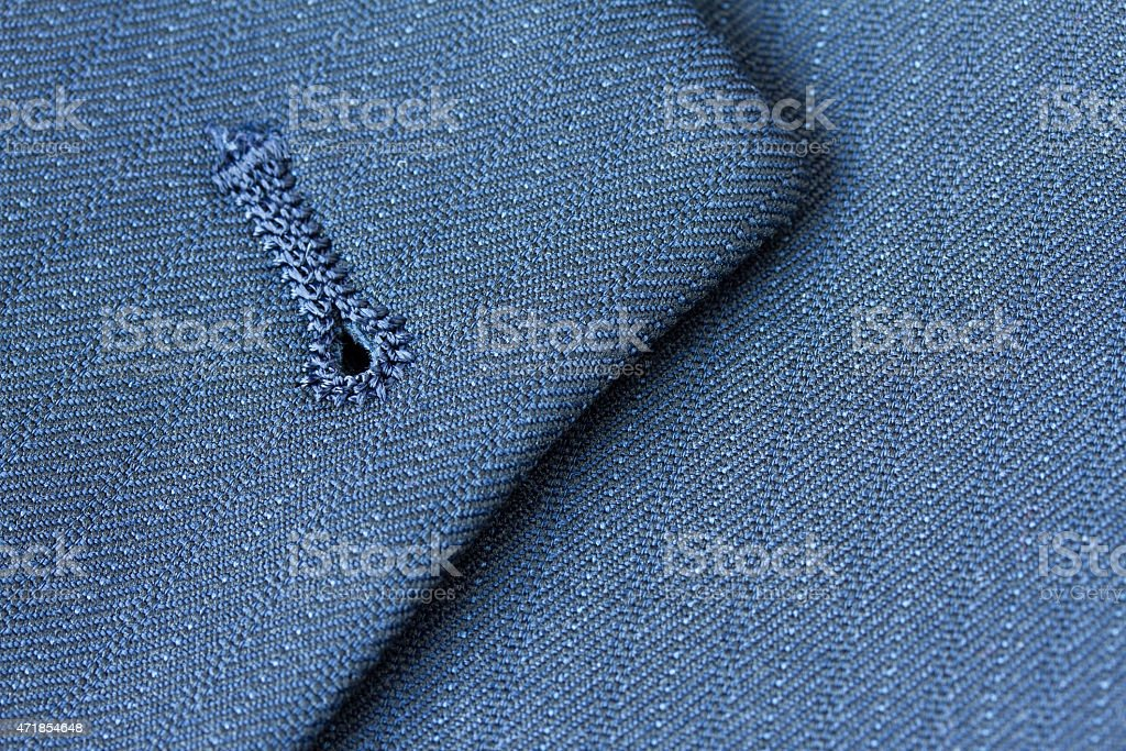 Close up detail of buttonhole on suit lapel stock photo