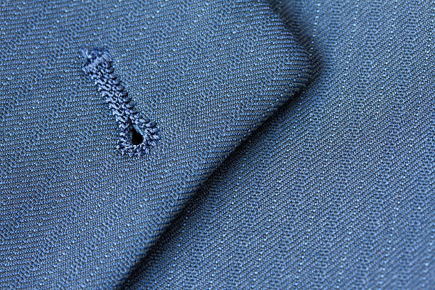 close up detail of buttonhole on suit lapel - jacket stock photos and pictures