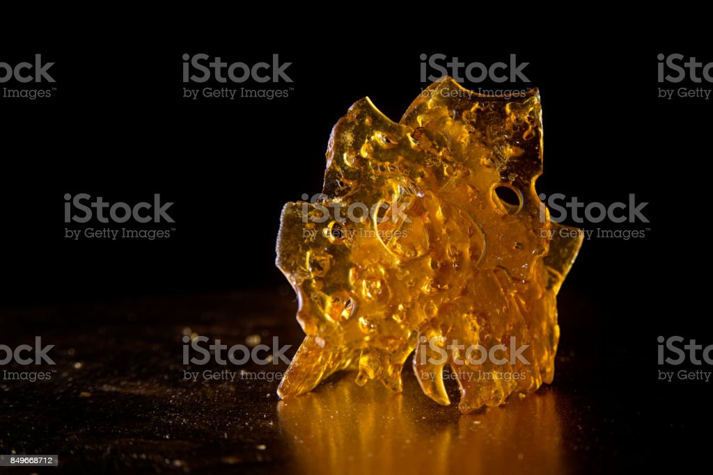 Close up detail of marijuana oil concentrate aka shatter stock photo