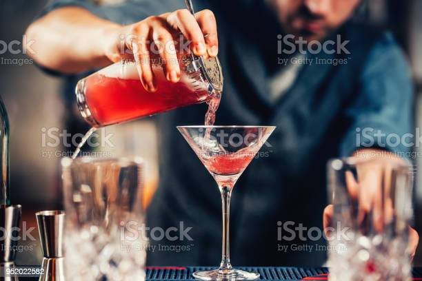 Close up details of barman pouring vodka cosmopolitan cocktail in picture id952022582?b=1&k=6&m=952022582&s=612x612&h=ew9phh8lgsuvzcv1vlbevvrjqu8 r6f9n0sza9e6igq=